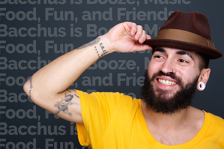 man-smiling-with-hat-on-gray-background-P4B3KGX.jpg