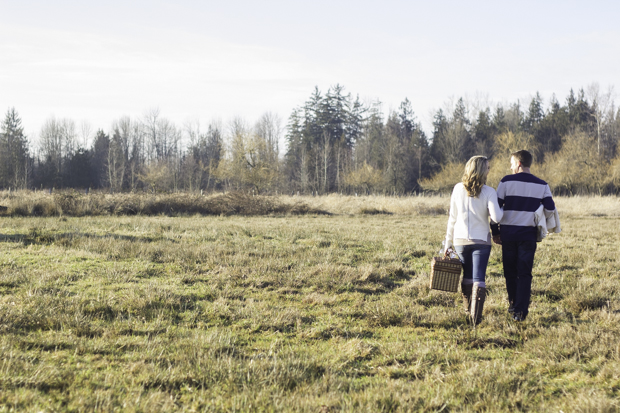 Engagement session walking in field
