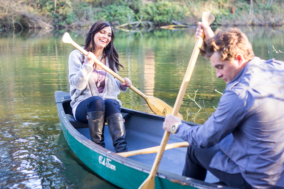engaged couple in canoe