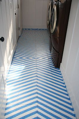 http://www.lovestitched.com/my-tutorial/how-to-paint-tile-floors-a-tutorial/