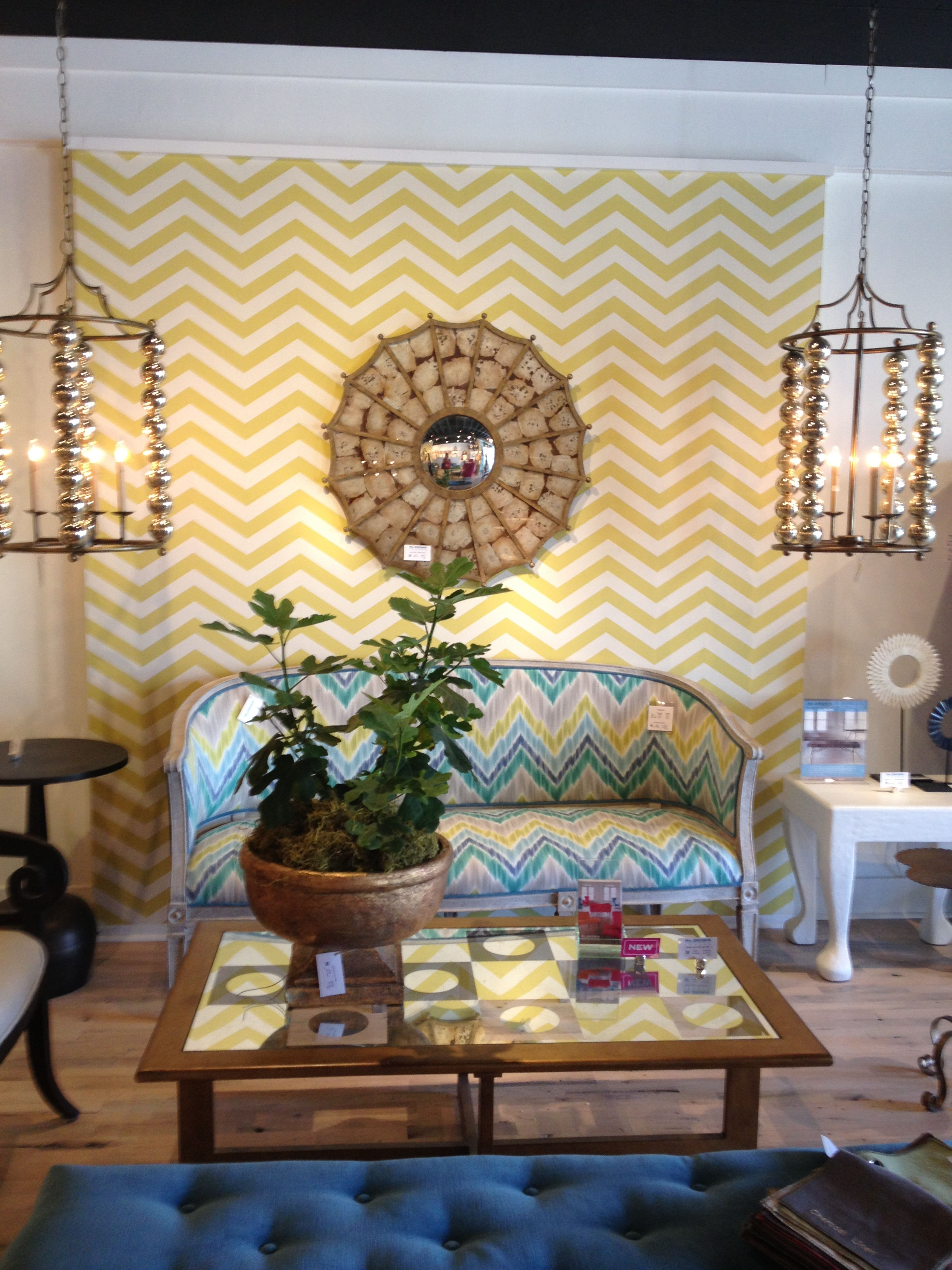Bold wallpaper and fun light fixtures.