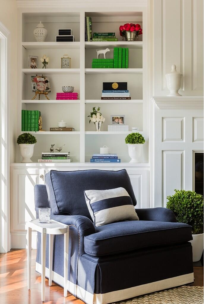 Found on oomphonline.com . The Oomph side table is too cute. I also love the banding on the chair. I did a very similar design on my newest purchase. The kelly green accessories have a big impact.