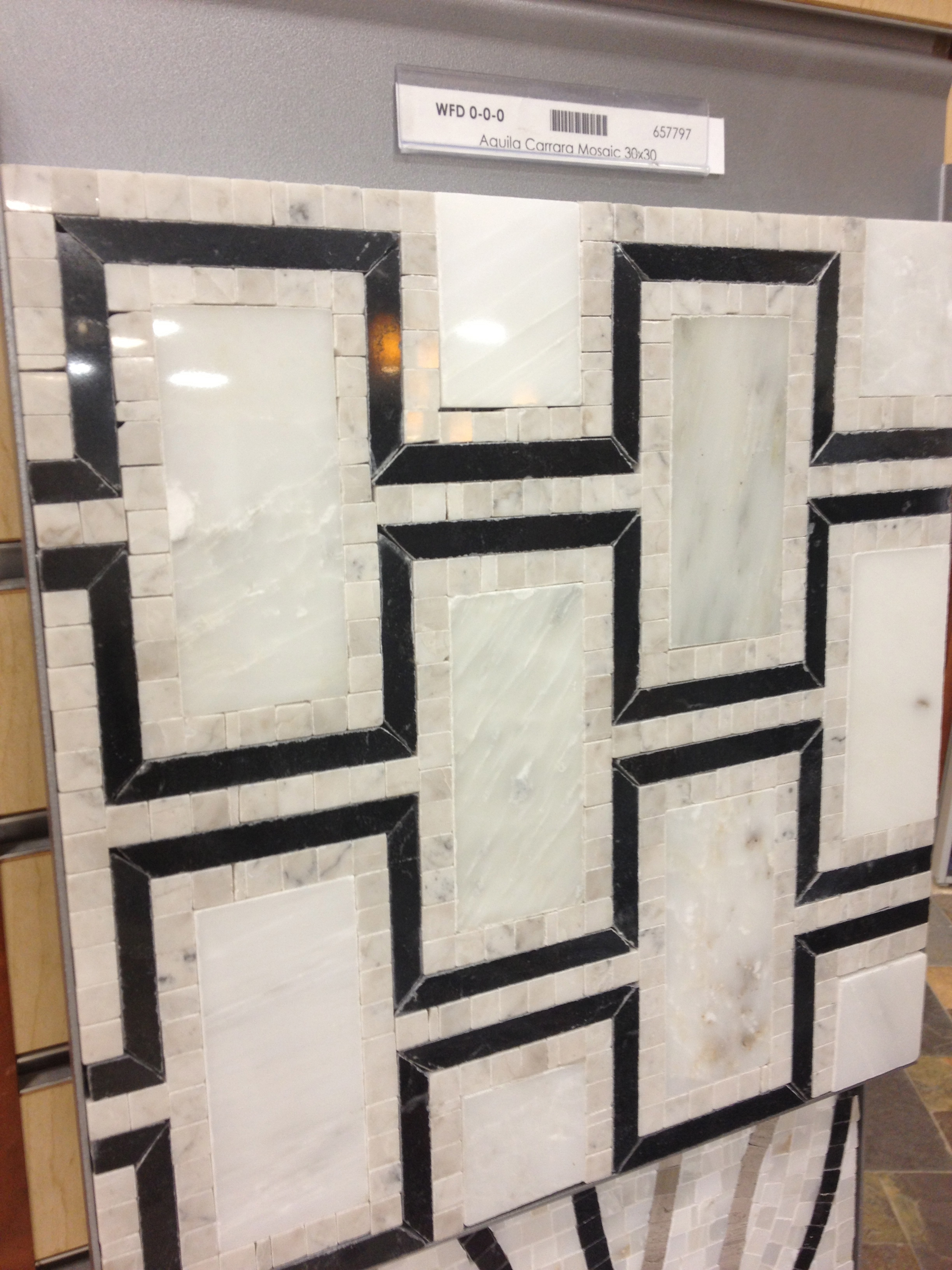 This beautiful mosaic is at the tile shop and while not cheap it beats the cost of it's peers at name brand tile manufactures.