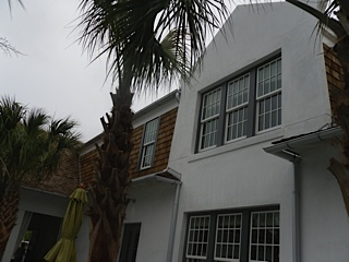 Love the contrast of the white stucco and warm wood shingles.