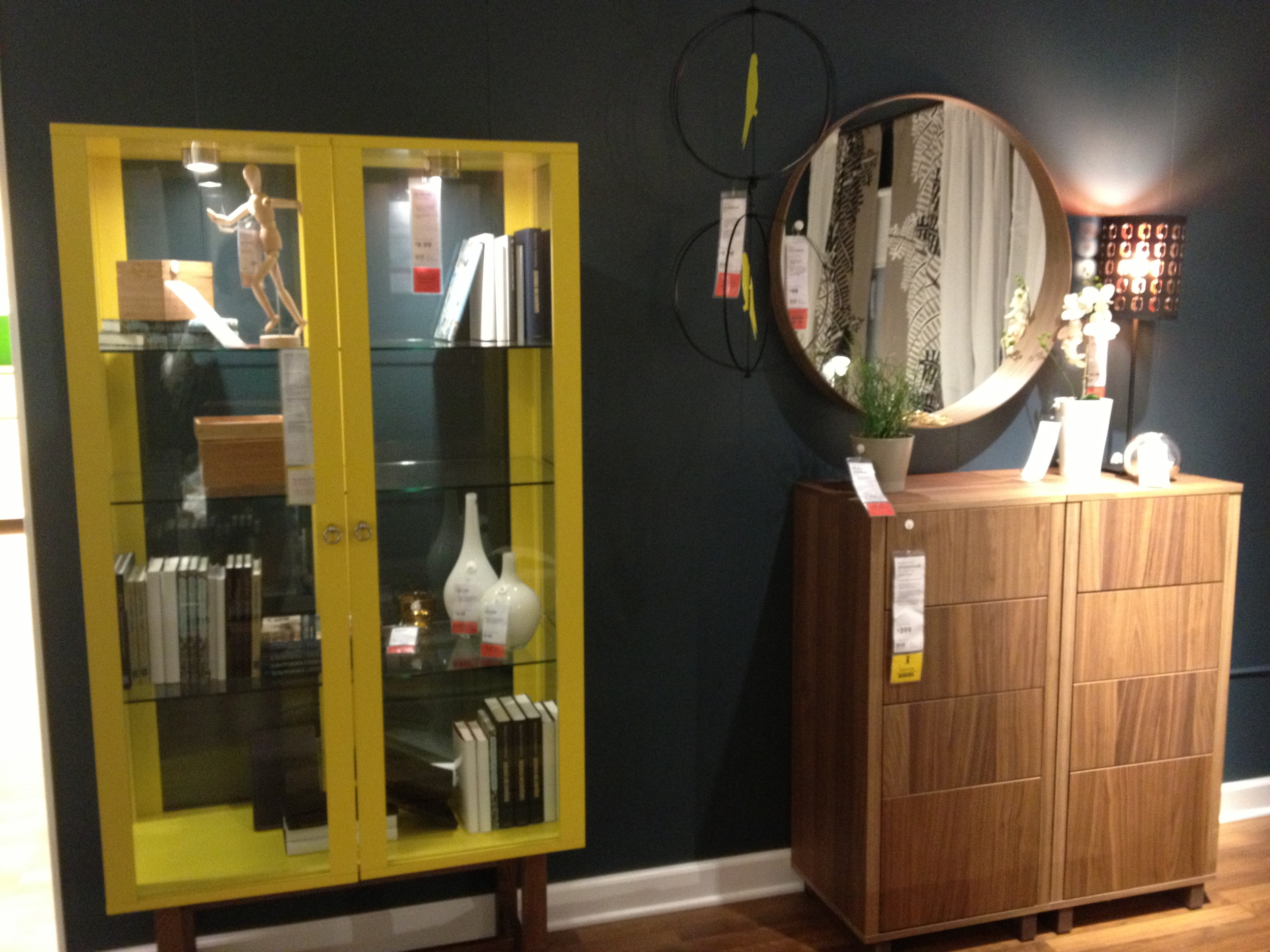 Love the pop of yellow and the round mirror.  Kansas City has IKEA!