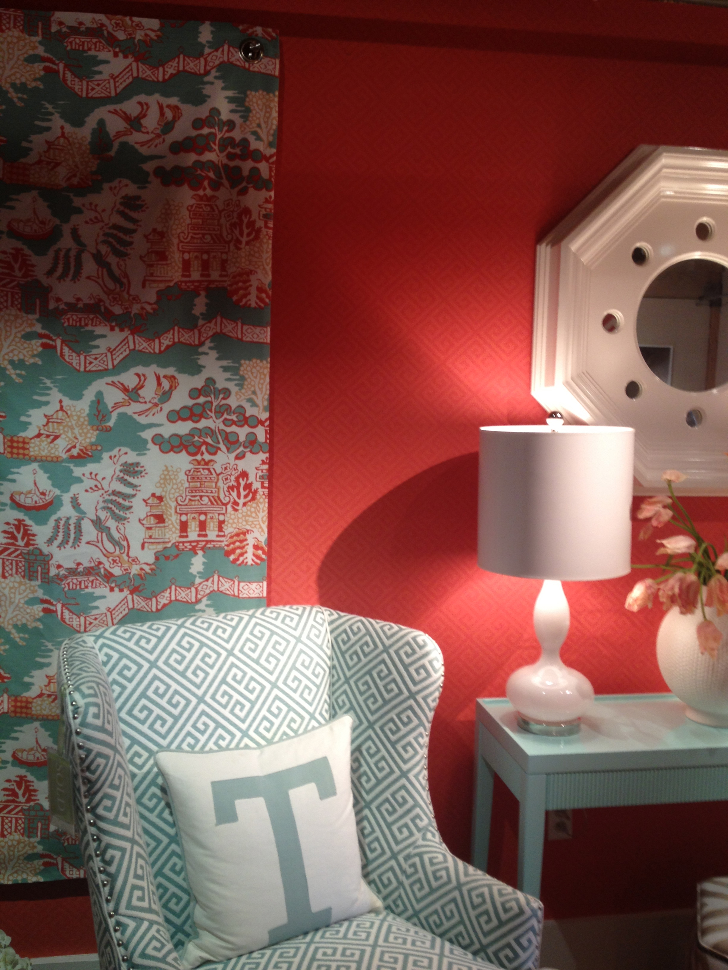 Thibaut's High Point showroom features a red wall with blue accents. Love it! www.saranobledesigns.com