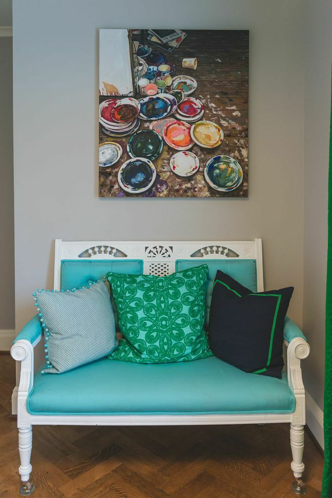 The sofa is redone in bright indoor/outdoor fabric. How perfect is her art piece over the sofa? Love!!! www.saranobledesigns.com