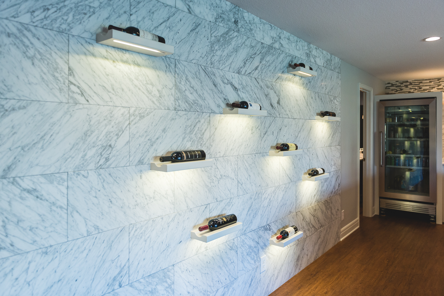 My other baby in this basement is the custom wine wall.  Love how the under lighting showcases the tile.  www.saranobledesigns.com