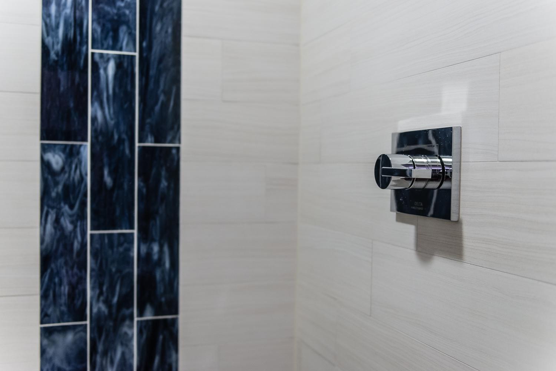 Modern fixtures made the plumbing a bit of art. www.saranobledesigns.com