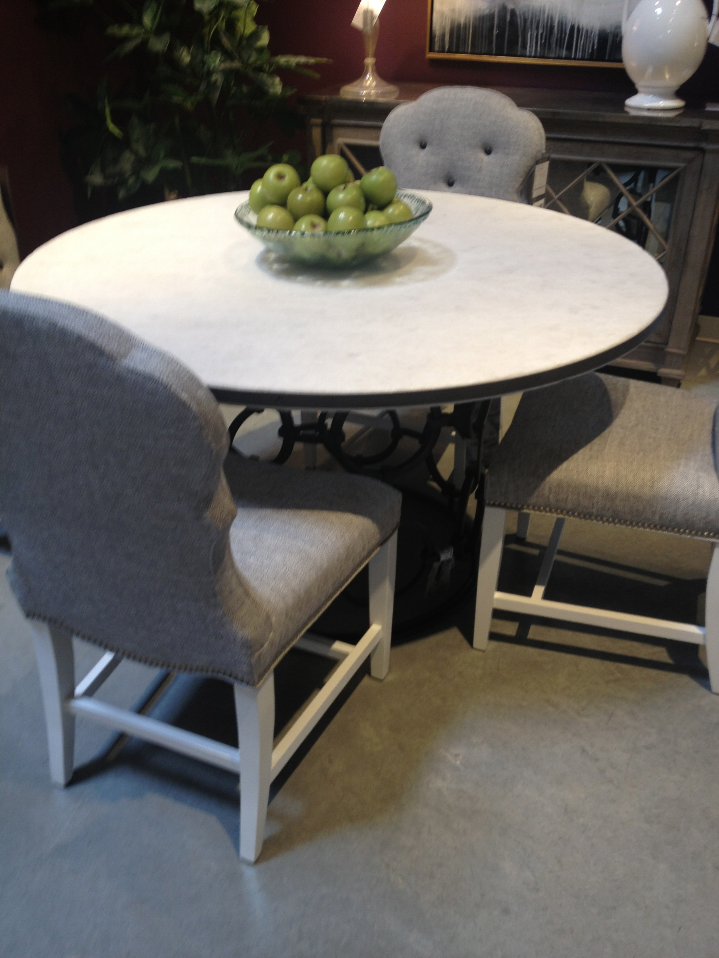 KDR displays this dining room table with an awesome stone tabletop.