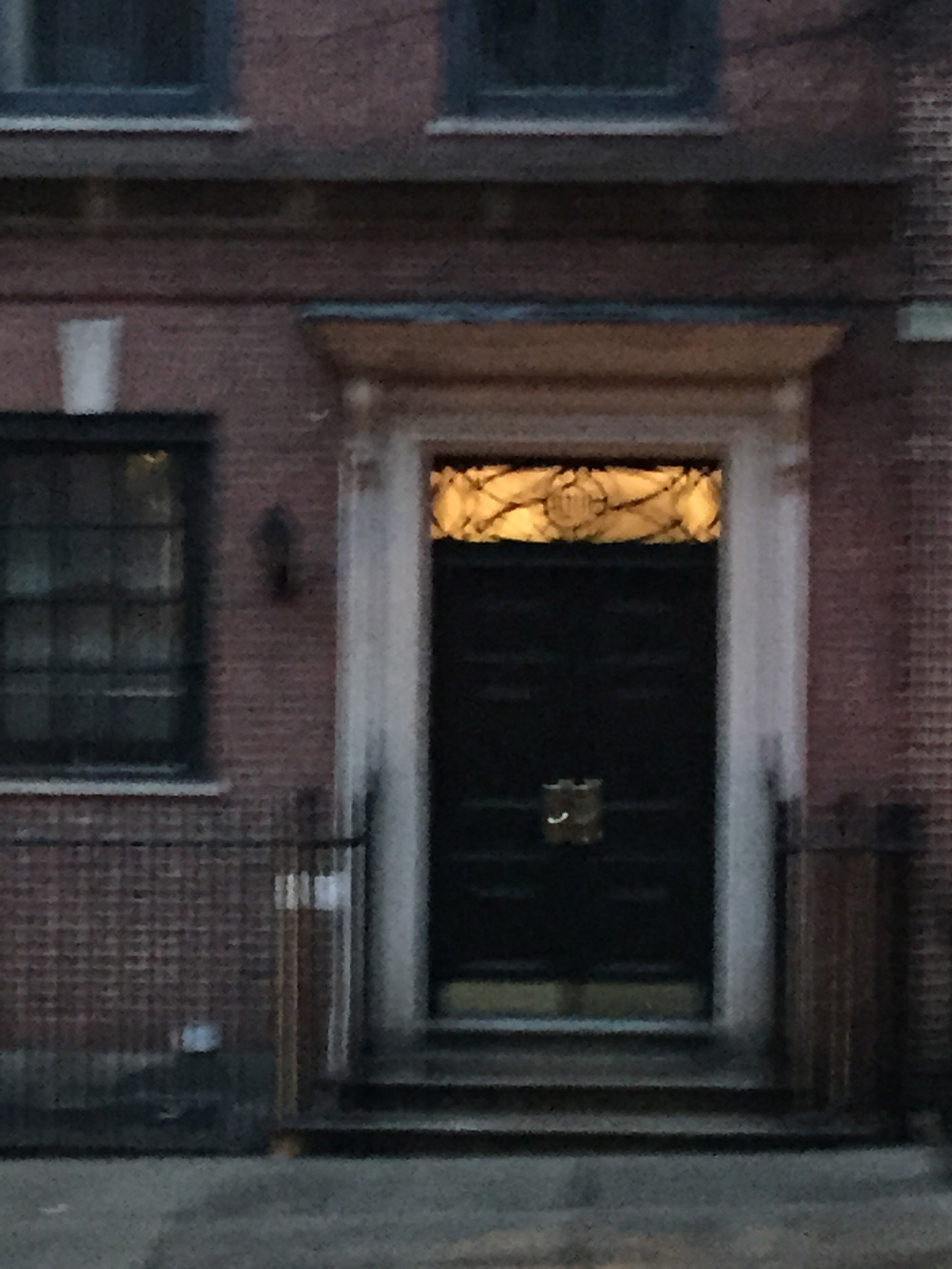 Probably shouldn't be including this blur of picture.  It was shot at the end of a long walk home in the light rain but I love the transom window above the door.  This could be a great detail to any project.  www.saranobledesigns.com