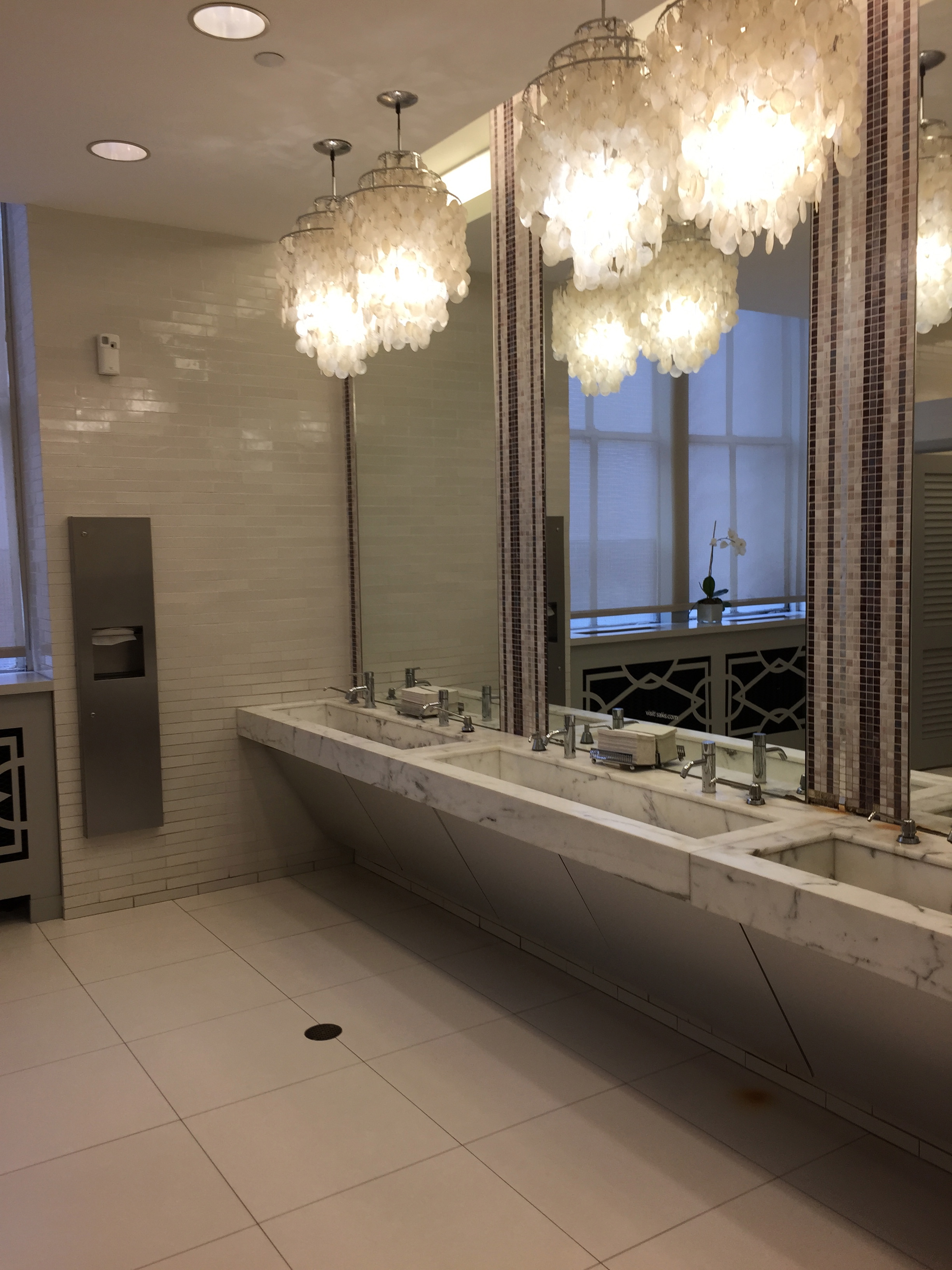 It felt a little weird to be taking pictures in the women's bathroom at Saks Fifth Avenue.  But isn't it fantastic?  The tiled walls, the marble counters, and the dramatic light fixtures and elements to repeat.  www.saranobledesigns.com