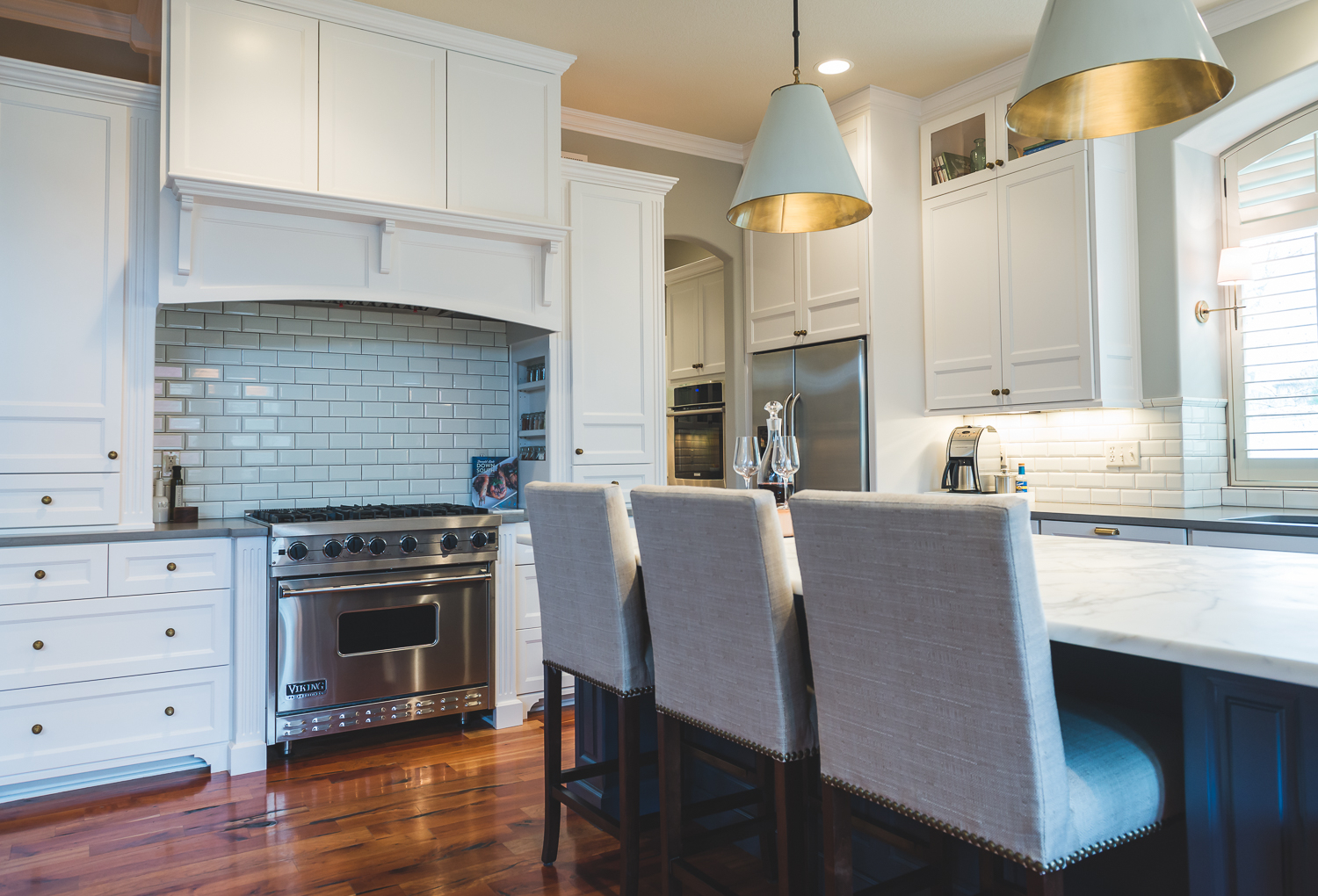 The white cabinets brightened the entire space and made the existing floors look better than ever. www.saranobledesigns.com
