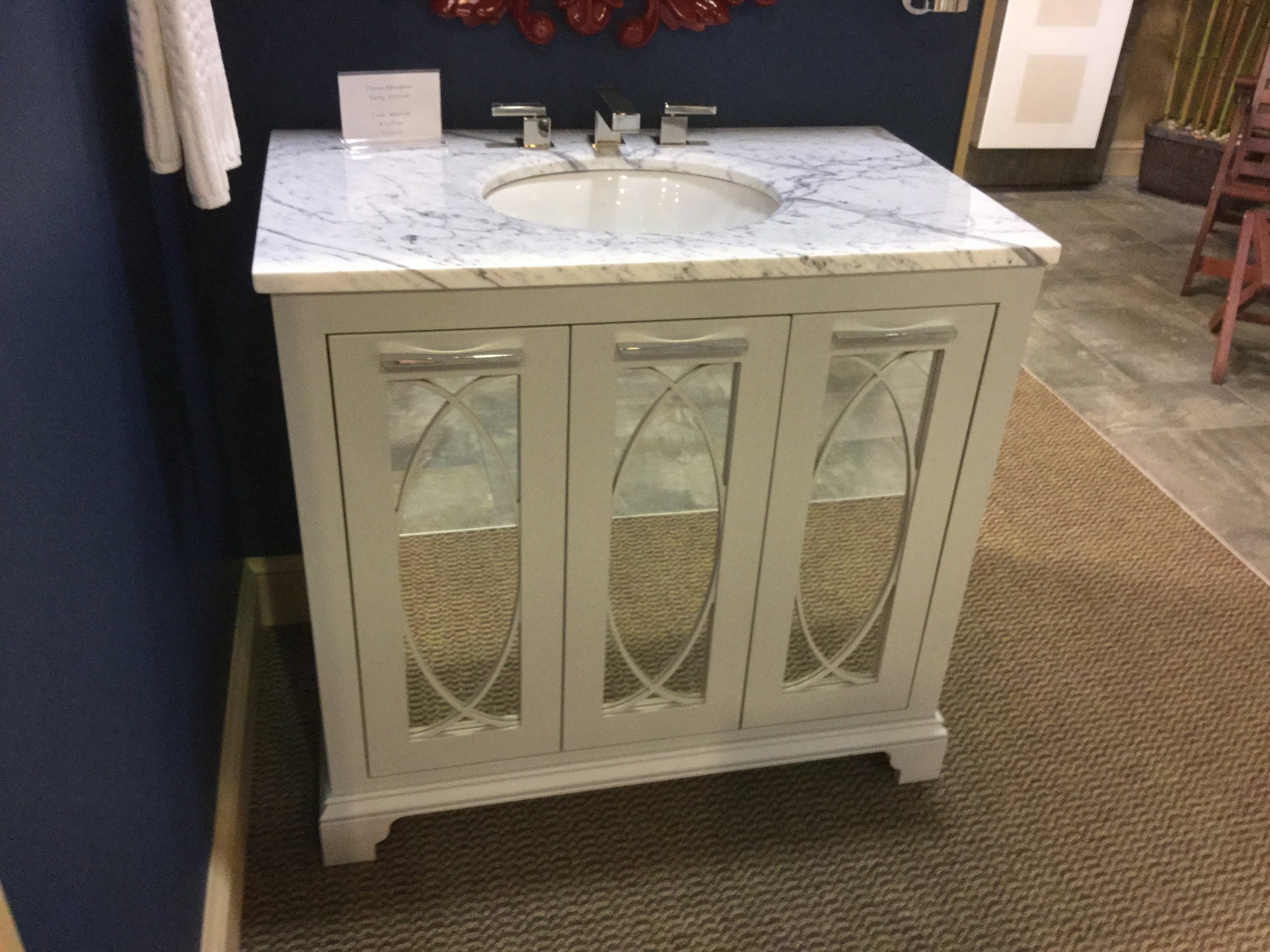 I love the detail of this mirror-front vanity.