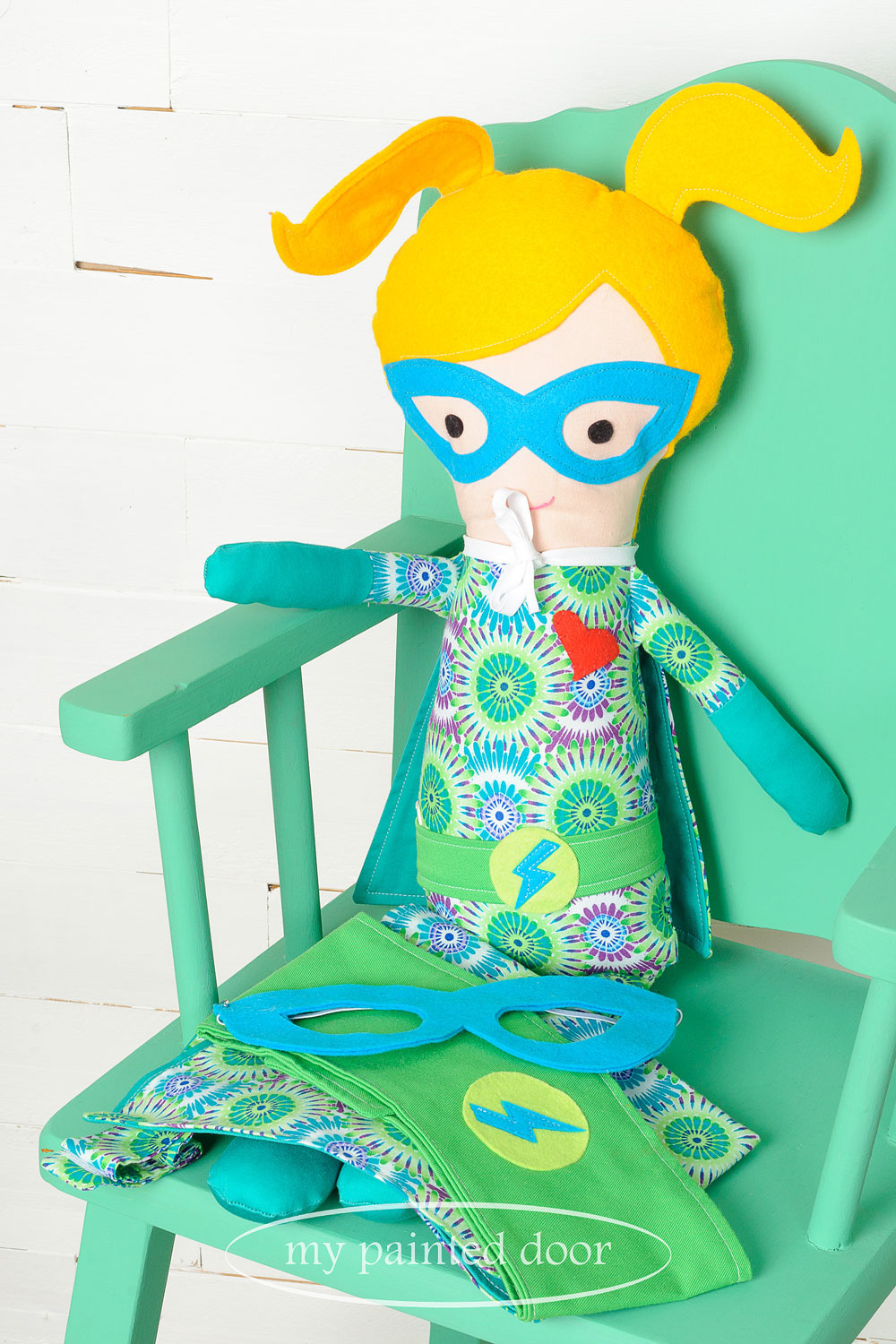 Chair painted in Fusion Mineral Paint in the colour Ceramic and superhero doll by  Sew Whimsical by Katie  - via My Painted Door (.com)