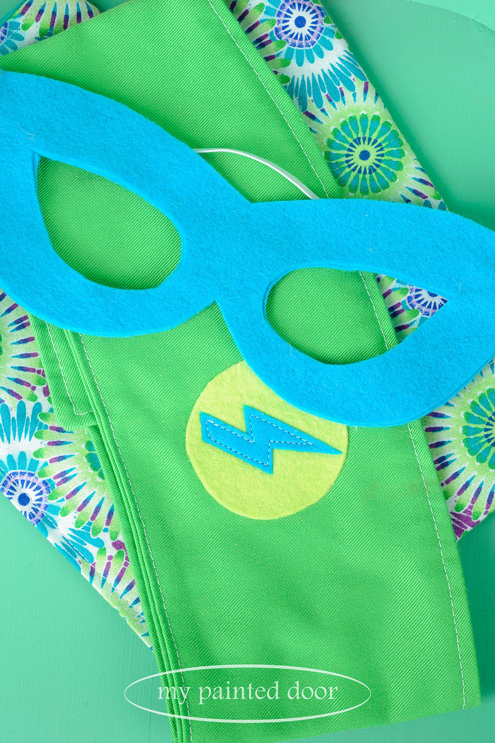 Child size superhero cape, belt and mask by  Sew Whimsical by Katie  - via My Painted Door (.com)