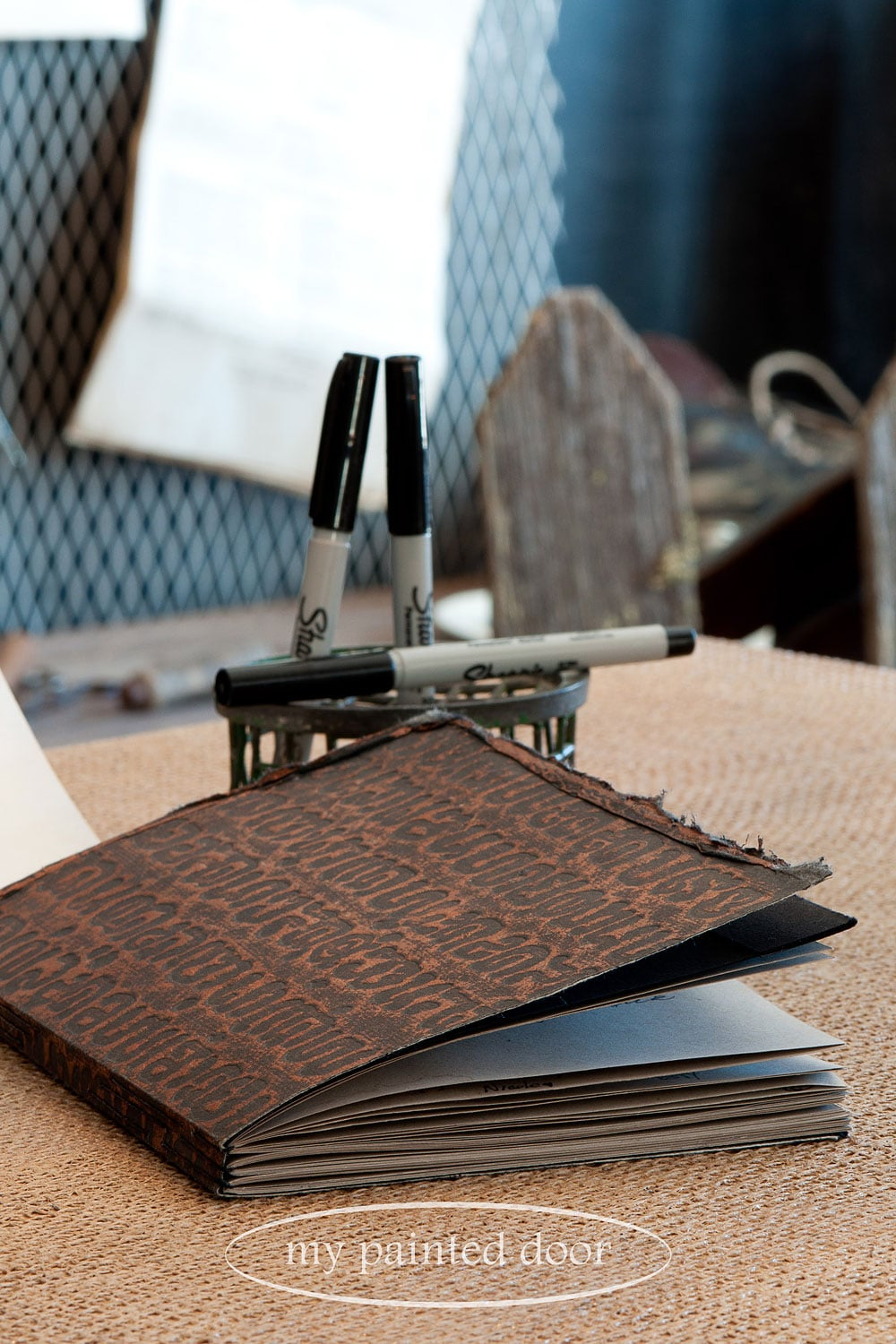 A beautiful guest book hand bound with a needle and thread