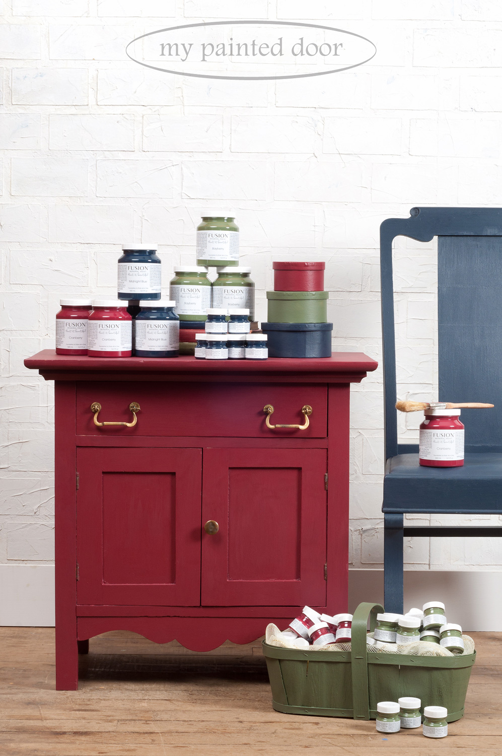 Washstand painted in Cranberry Fusion Mineral Paint. Chair painted in Midnight Blue and wood basket painted in Bayberry.