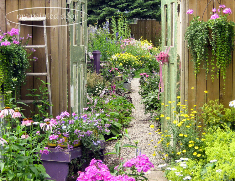This is the country garden of Sue Sikorski, the owner of My Painted Door. Sue used old doors as garden gates when you enter her garden.