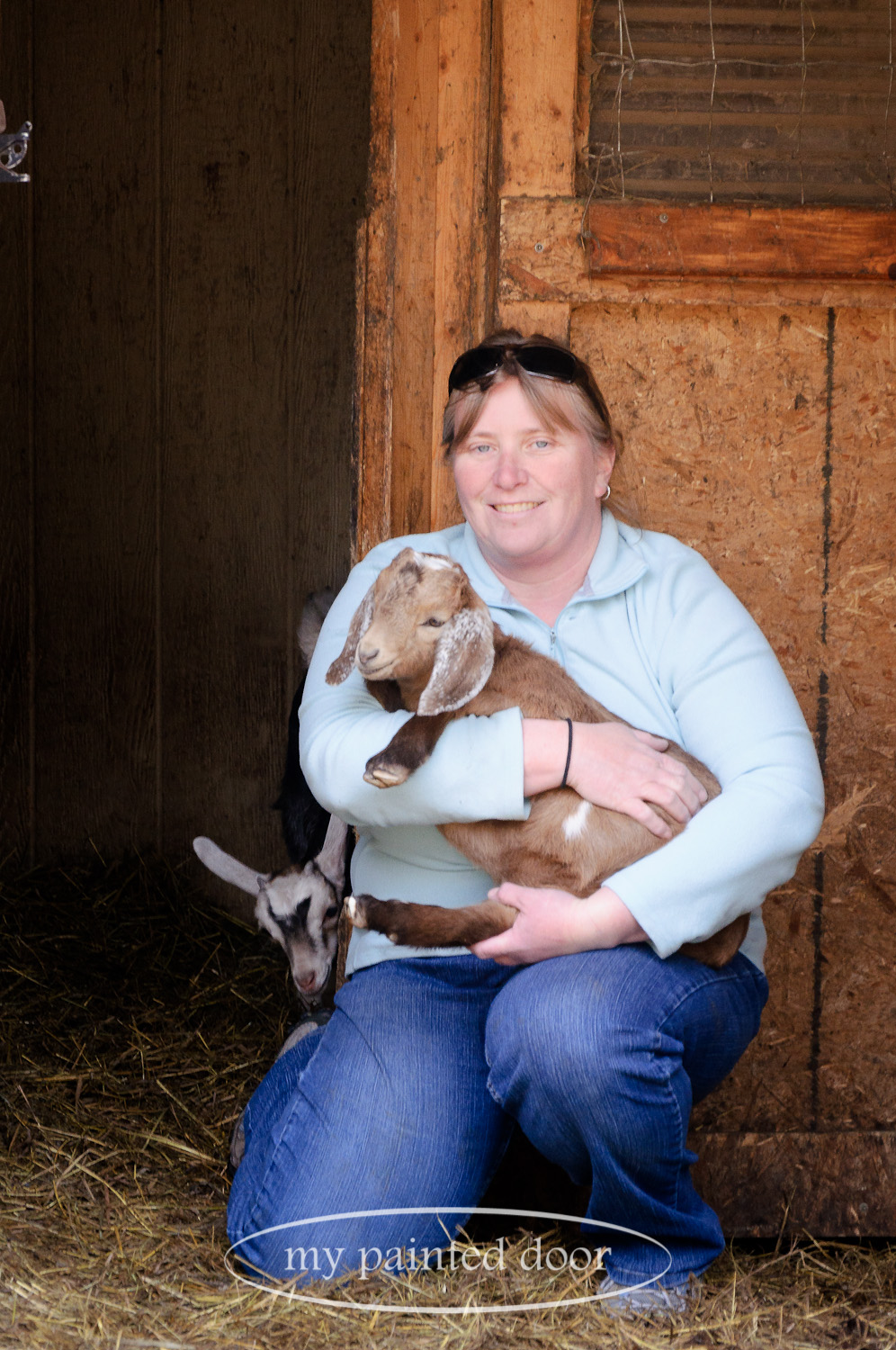 Kirsten Spence from Hurkett Hill Farm and a couple of her baby goats