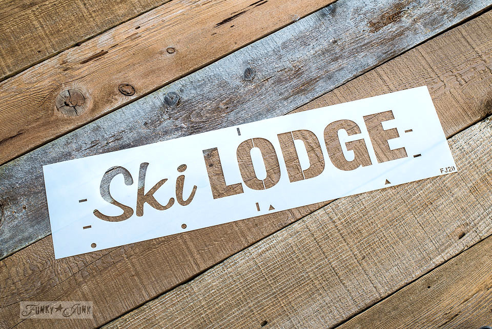 Ski Lodge stencil on an old wood table. Funky Junk Old Sign Stencils - available at My Painted Door.