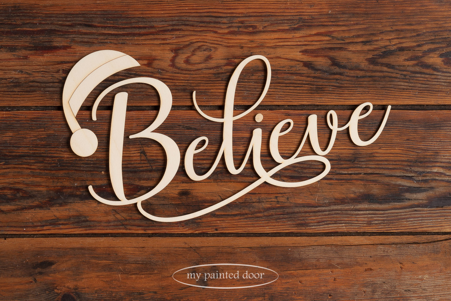 Laser cut word - Believe with Santa hat - available online at My Painted Door