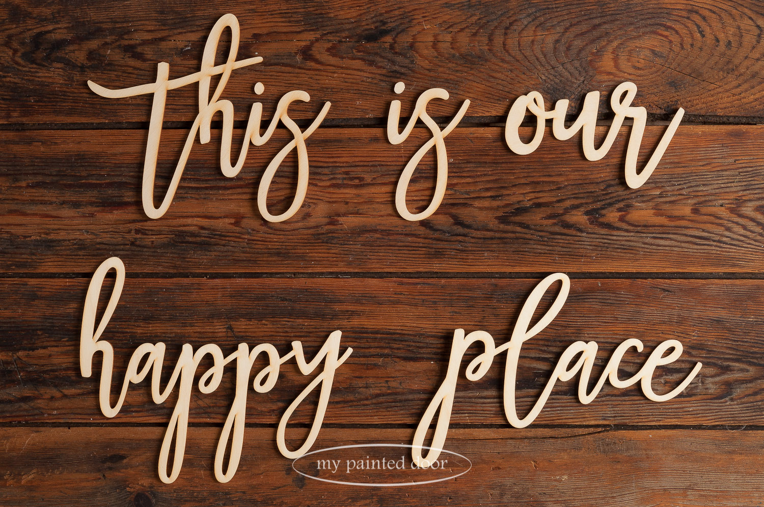 This is our happy place. Laser cut words available online at My Painted Door.