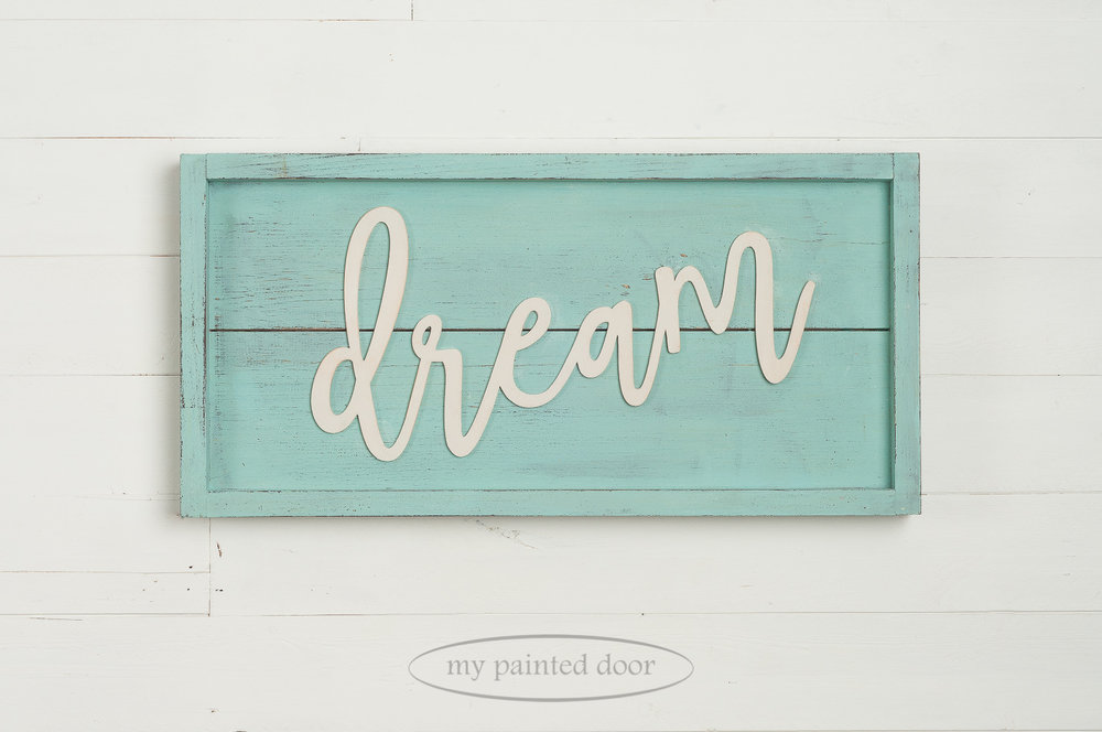 Sign with laser cut word dream. Painted in Miss Mustard Seed's Milk Paint in the colours Curio, Eulalie's Sky and Farmhouse White. Laser cut words are available online at My Painted Door.