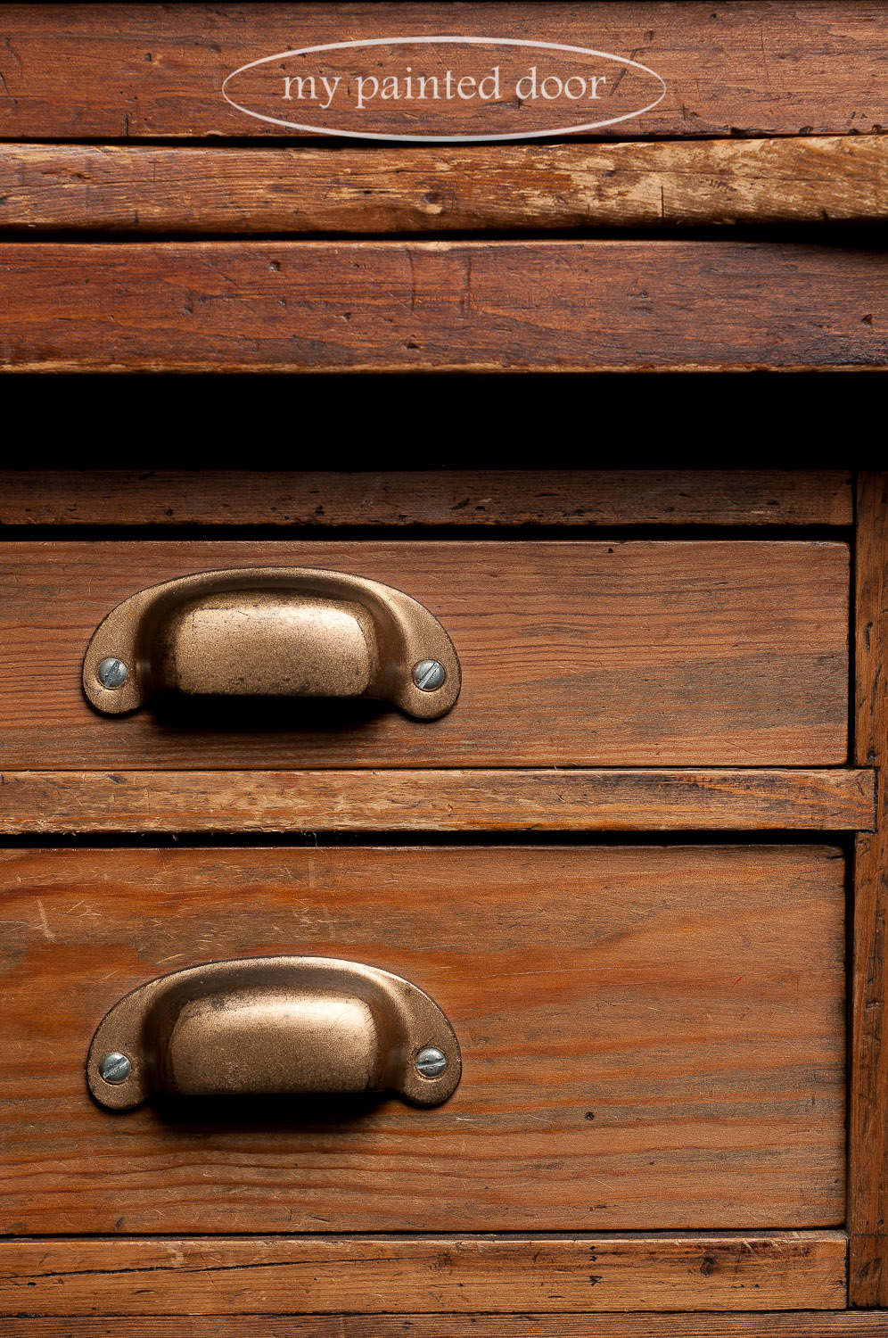 Drawer pulls on an antique post office desk.