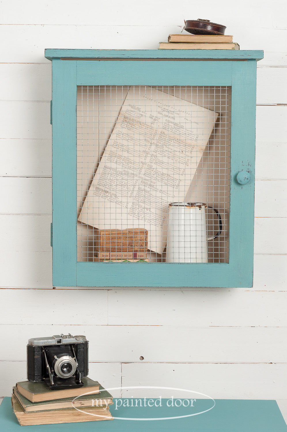 Learn how to paint furniture - Curiosity cabinet painted with Homestead House Milk Paint in the colour Niagara Green.