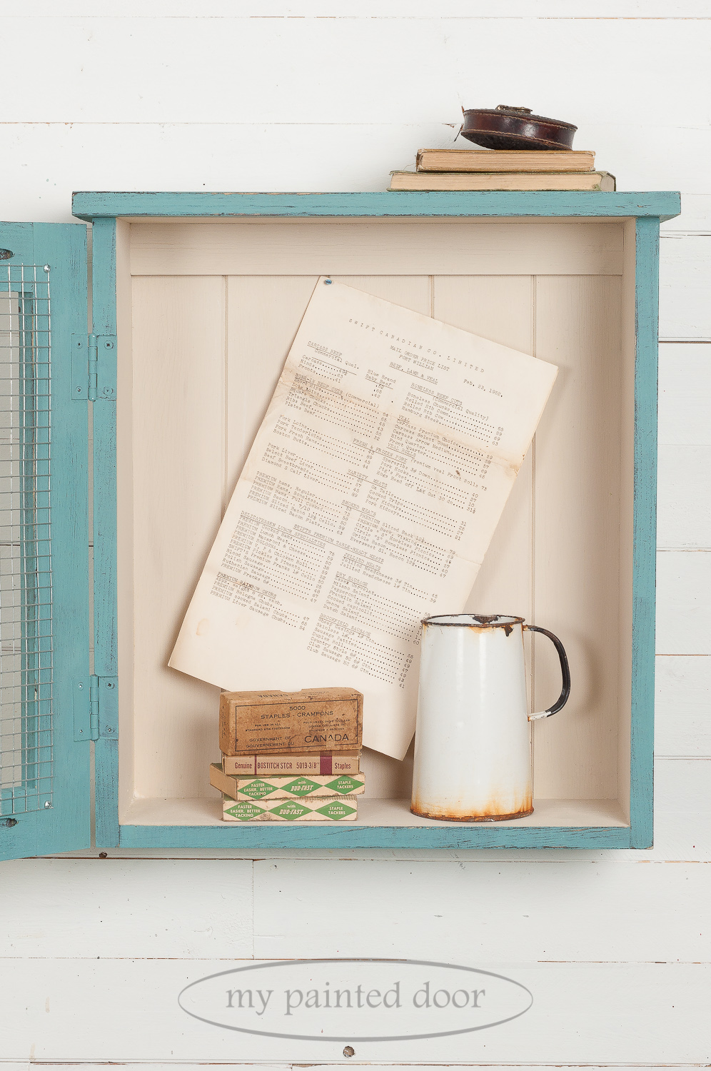 Learn how to paint furniture - Curiosity cabinet painted with Homestead House Milk Paint in the colours Niagara Green and Champlain.