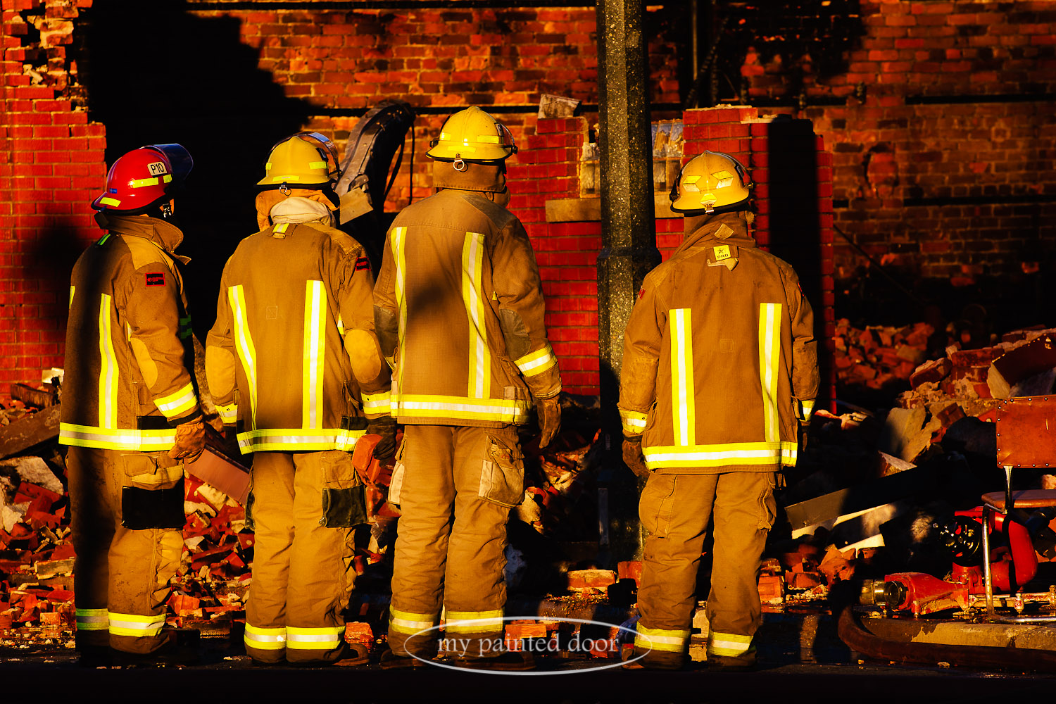 Thunder Bay firefighters view the aftermath of the West Hotel fire.