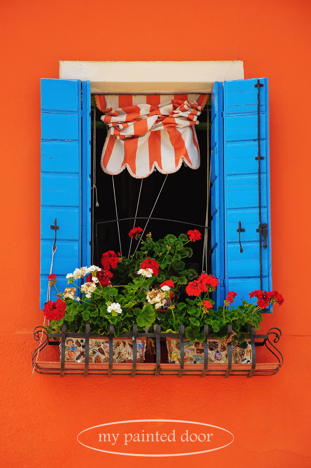 Colourful window box and shutters in Burano, Italy.