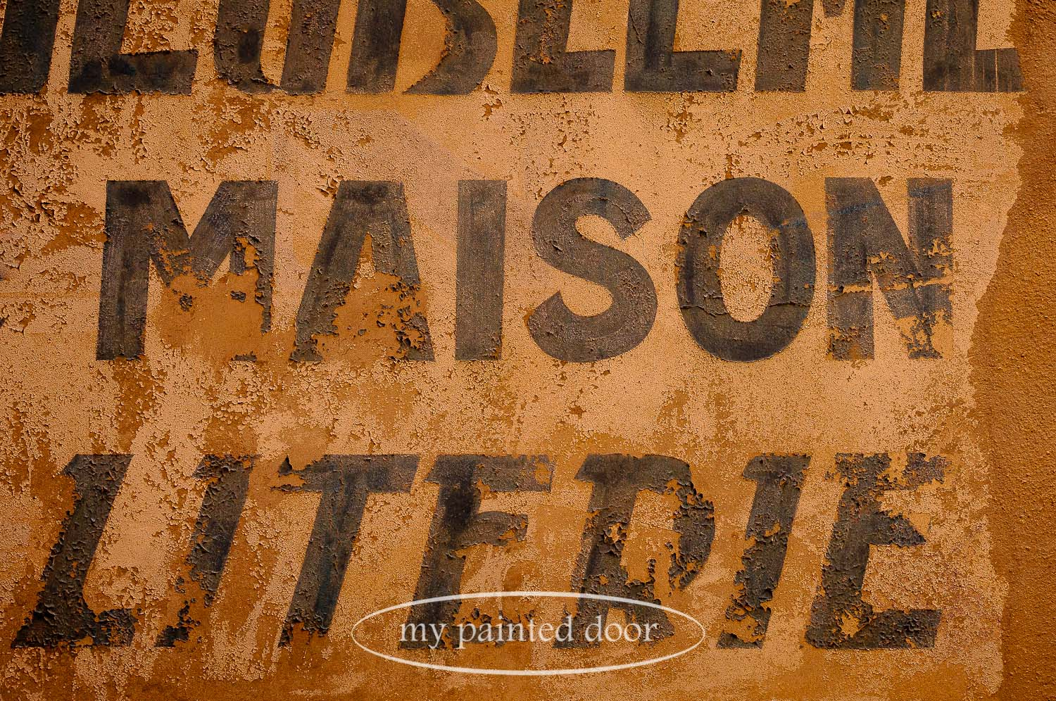 Old sign in France with chippy paint.