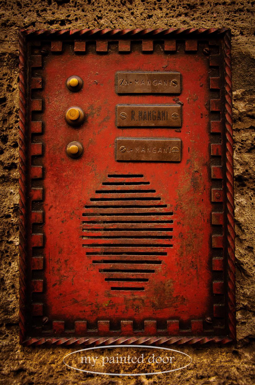 Bright red intercom system in Italy.