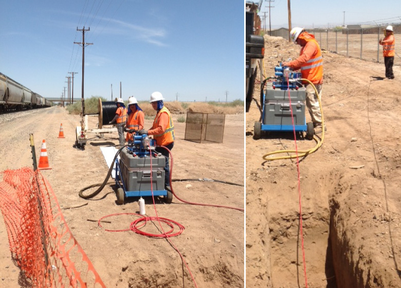 Under the hot desert sun, HP Crew is using a Condux Fiber Optic Cable Blower to blow microfiber into Duraline's 10/8 microduct.