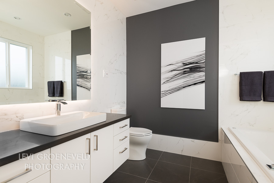 The focal point of this master bathroom is a photograph printed on acrylic by  Levi Groeneveld . The design of the room was inspired by this piece and is one of my favourite rooms in the house.