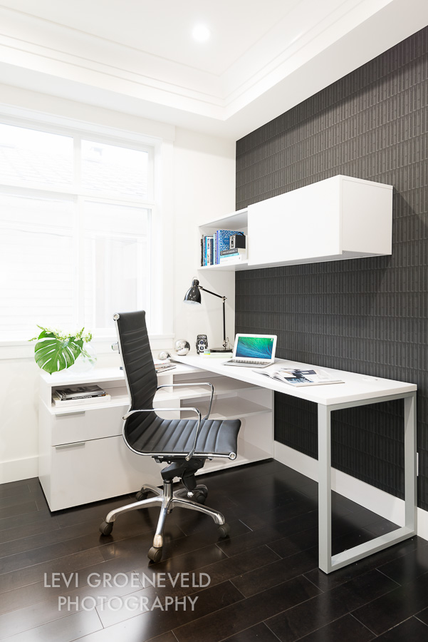 The office, located just off of the great room, also features a geometric wall covering to add interest to the space. The desk offers plenty of storage and workspace for at home affairs.