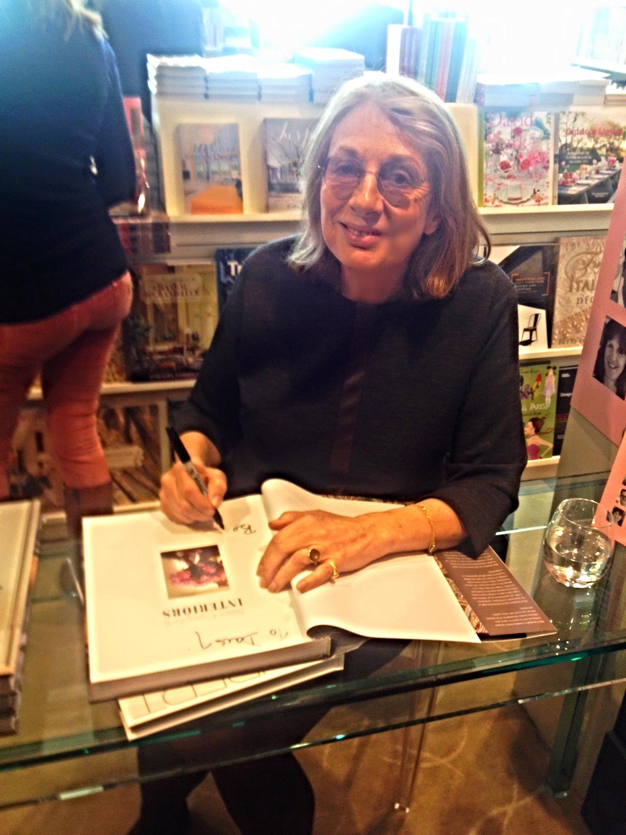 """Interior Designer Nina Campbell signing Daisy's copy of """"Interiors"""""""