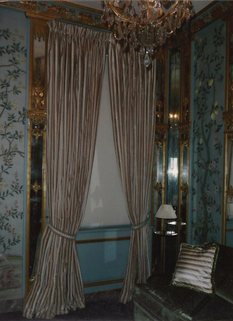 """Kuwait- Stripe silk curtains with """"Holland"""" roller blind in room with hand painted fabric upholstered panel walls"""