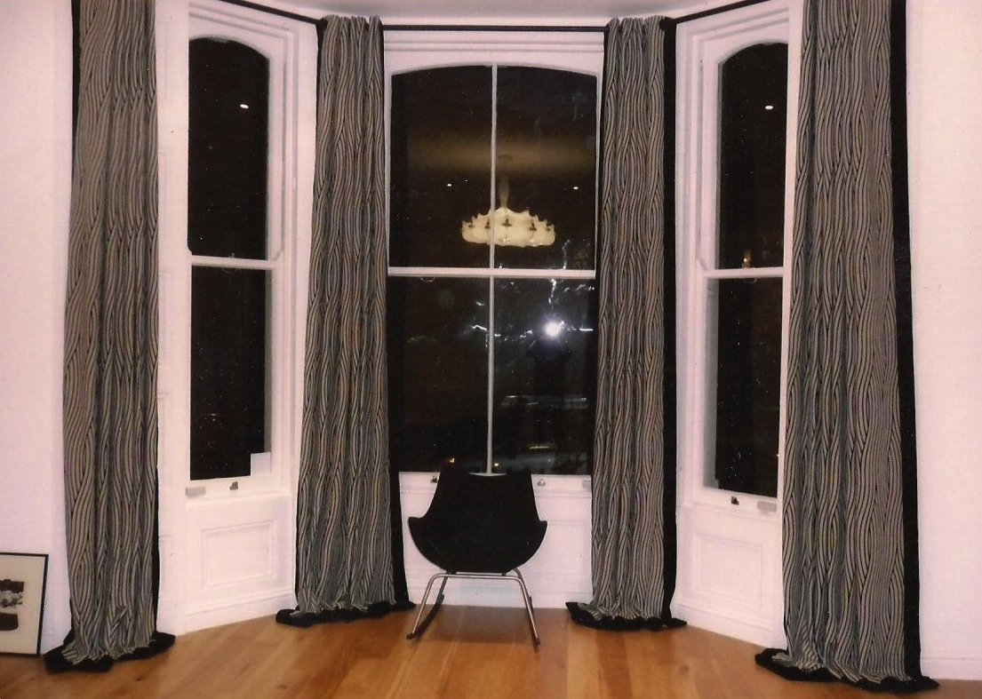 London Town House- Curtains made from Designers Guild black and white fabric with black borders. Eyelet heading on a black bay pole