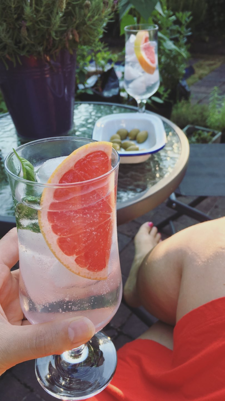 Gin and tonics in our backyard last July.