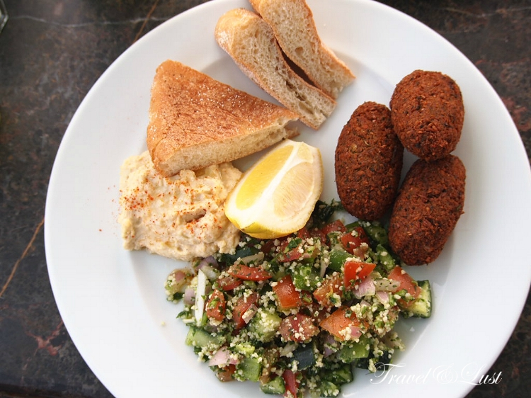 The falafel dish with hummus and tabbouleh is delicious.
