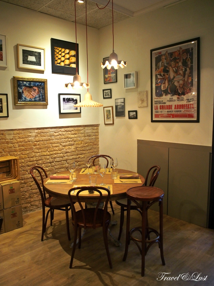 Cute corner with cardboard covered lamps, brick lay outs and memories on the walls.