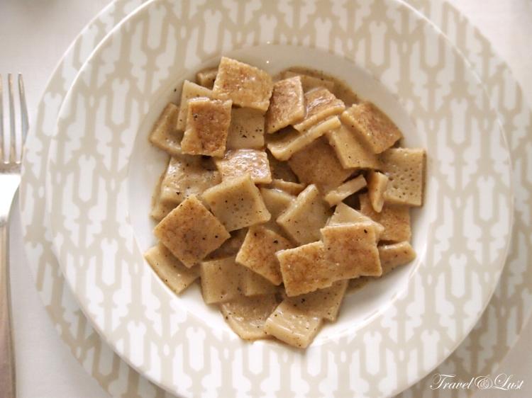Testarolo (Ludigiana wheatflour pancake) with mature cheese and black pepper.