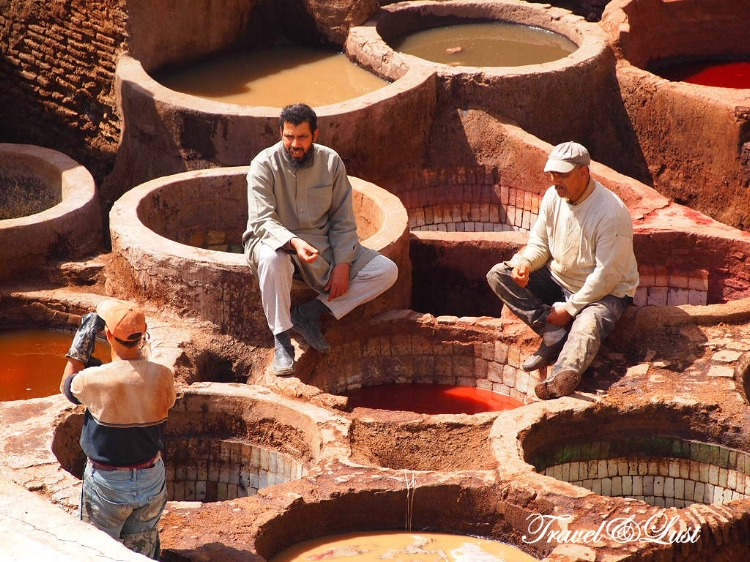 Workers in the tannery dyeing vats at the Chouara Tannery.