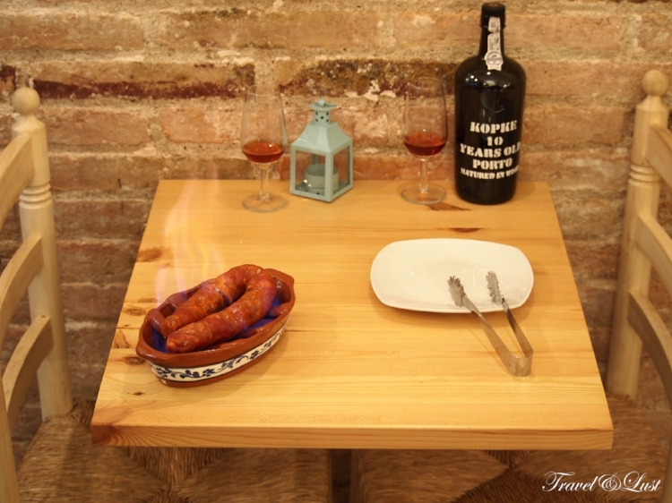 The table side grilled chouriço (grilled blood sausage) or 'chorizo al infierno' as it is being cooked.