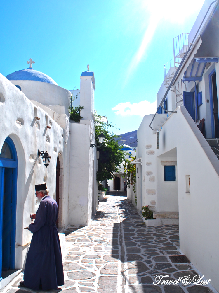 Priest near the church in the narrow cobbled streets of Parikia.