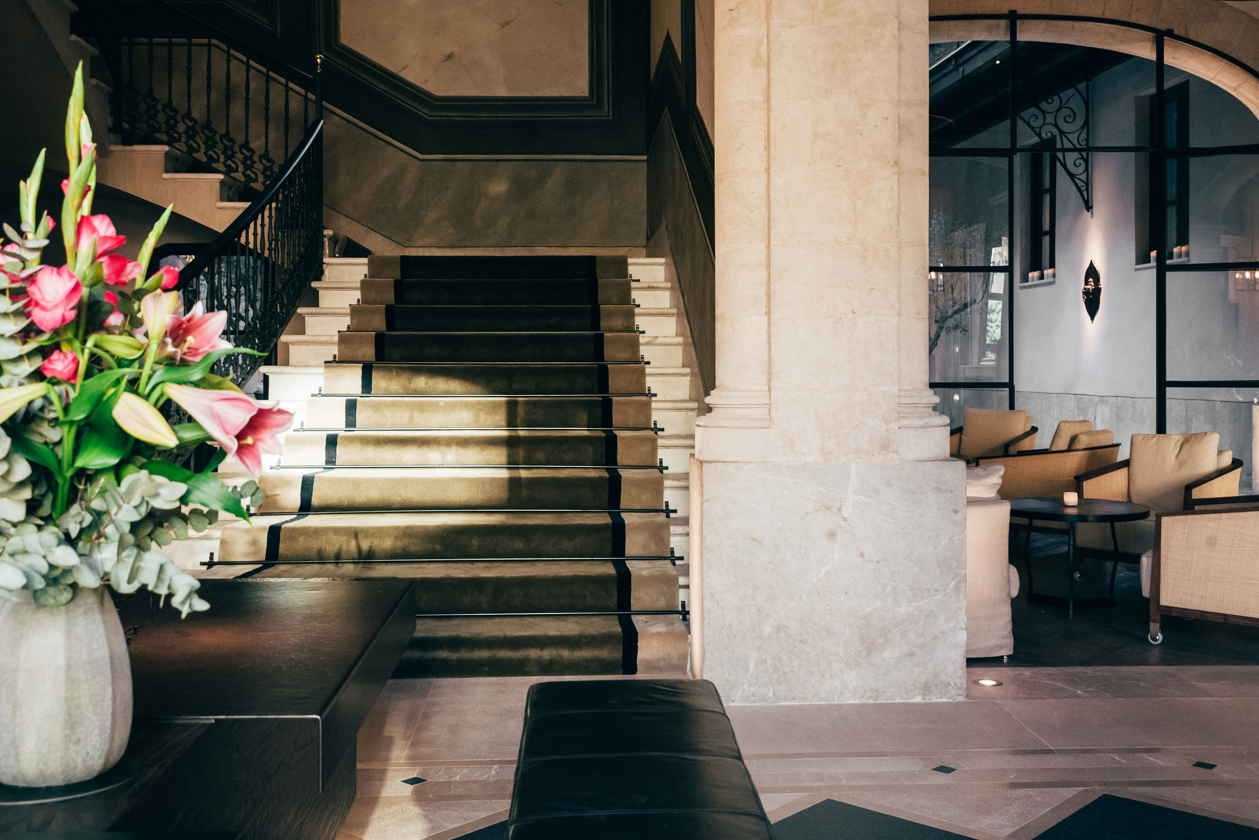 The majestic reception of Hotel Sant Francesc. Original features and specially commissioned artworks are all on display at this intimate property.