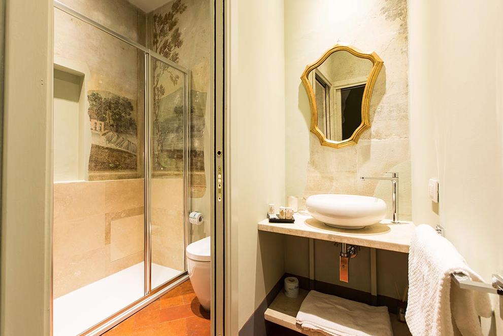 Canto de' Banderai bathroom with Italian frescoes in the shower.